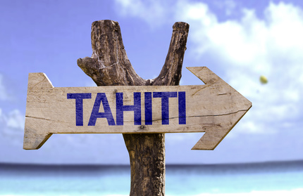 Tahiti wooden sign with a beach on background